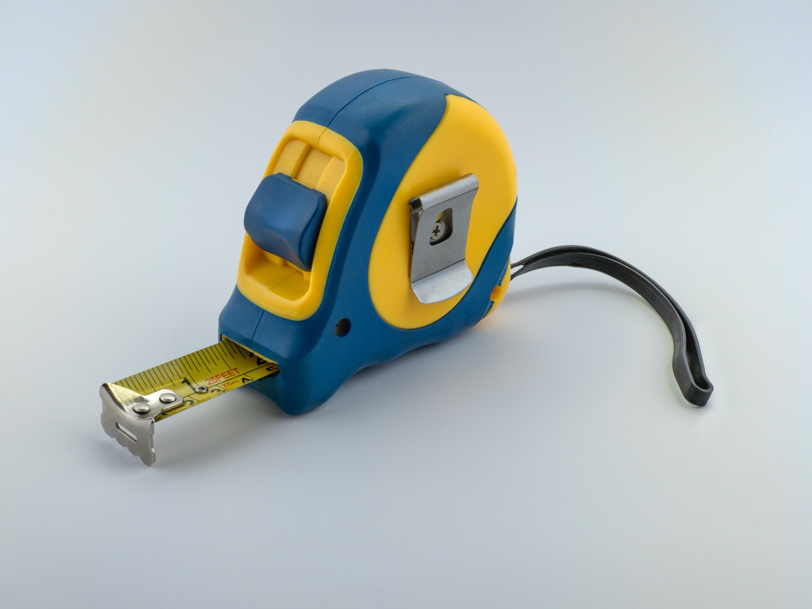 blue and yellow measuring tape